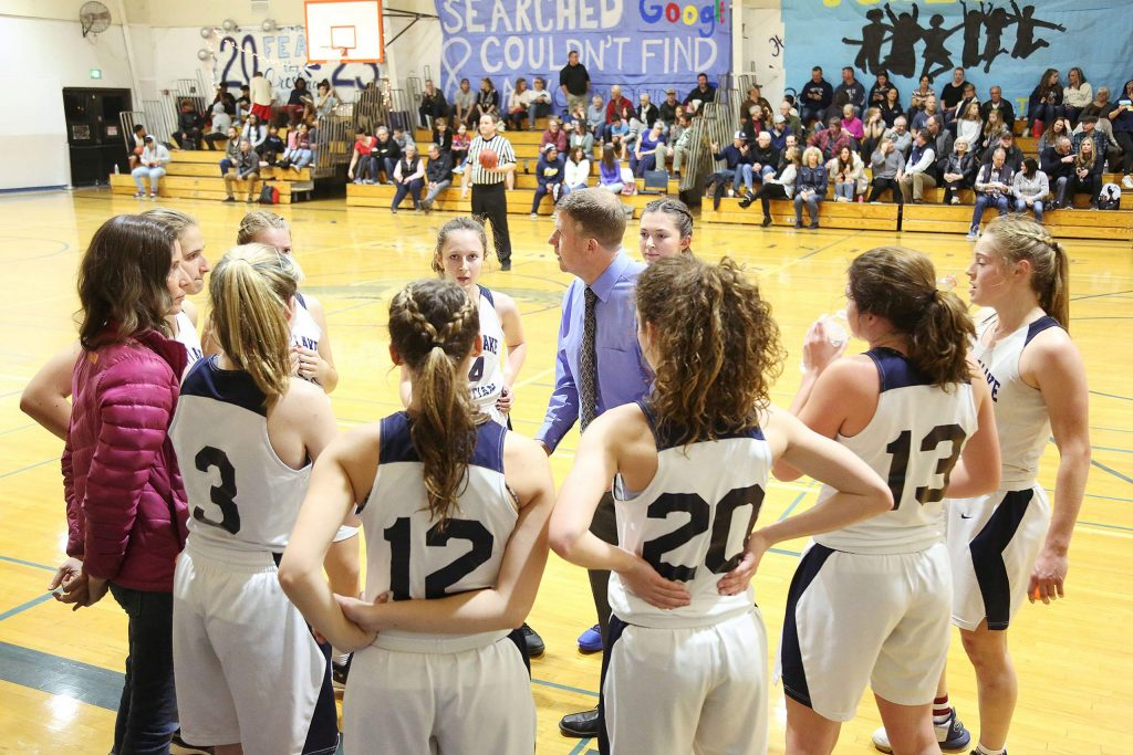 Forest Lake Christian varsity girls basketball head coach John McDaniel talks to his team during a timeout against Friday's homecoming game against Futures.