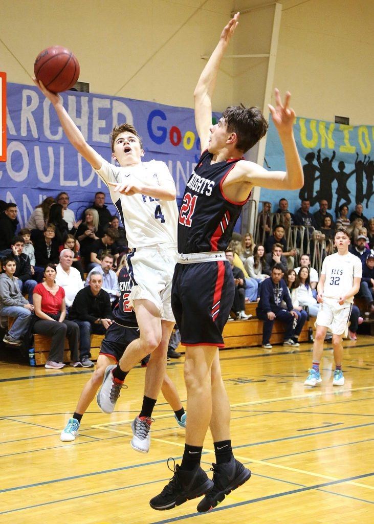 Forest Lake Christian sophomore guard Evan McDaniel (4) puts up a two point shot while Futures' forward Simon Kolosov (21) defends during Friday's homecoming matchup against the Knights.