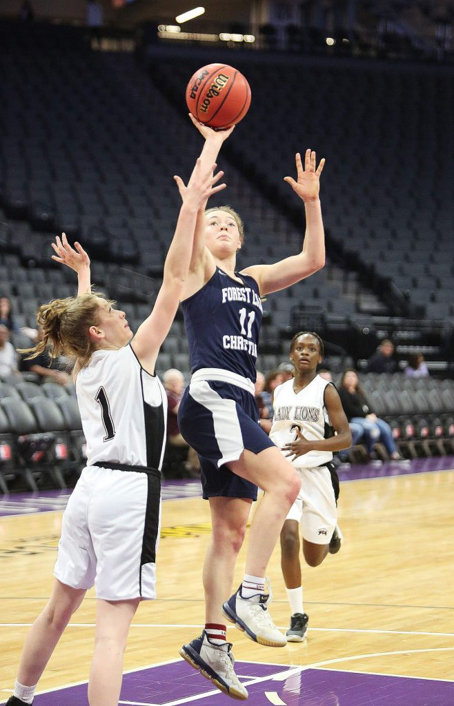 Forest Lake Christian's Amber Jackson (11) elevates to the basket during Thursday's section championship game against the Valley Christian Lions.