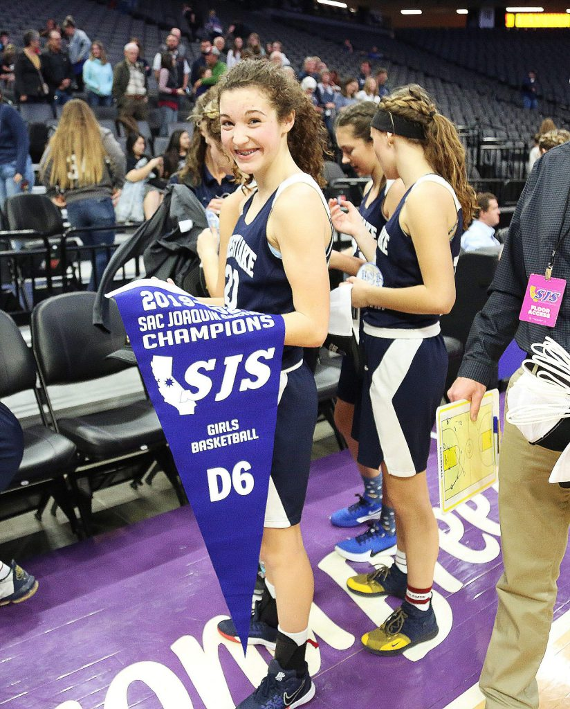 Forest Lake Christian freshman Sadie Whaley (20) grins as she walks off the court with the D-6 Sac-Joaquin Section title.