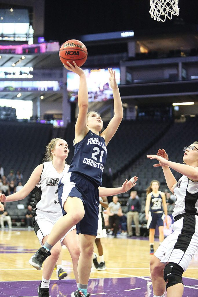 Forest Lake Christian's Ellie Wood (21) goes up for a lay-up against Valley Christian.