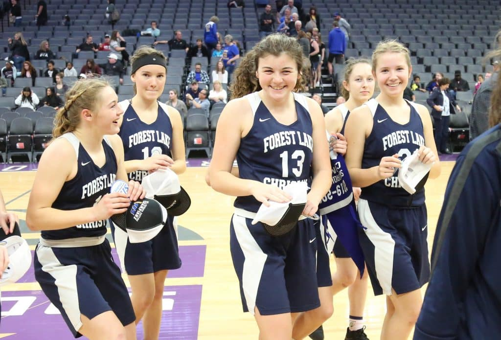 The Forest Lake Christian varsity girls basketball team reacts after their championship win over the Valley Christian Lions Thursday morning at the Golden 1 Center in Sacramento.