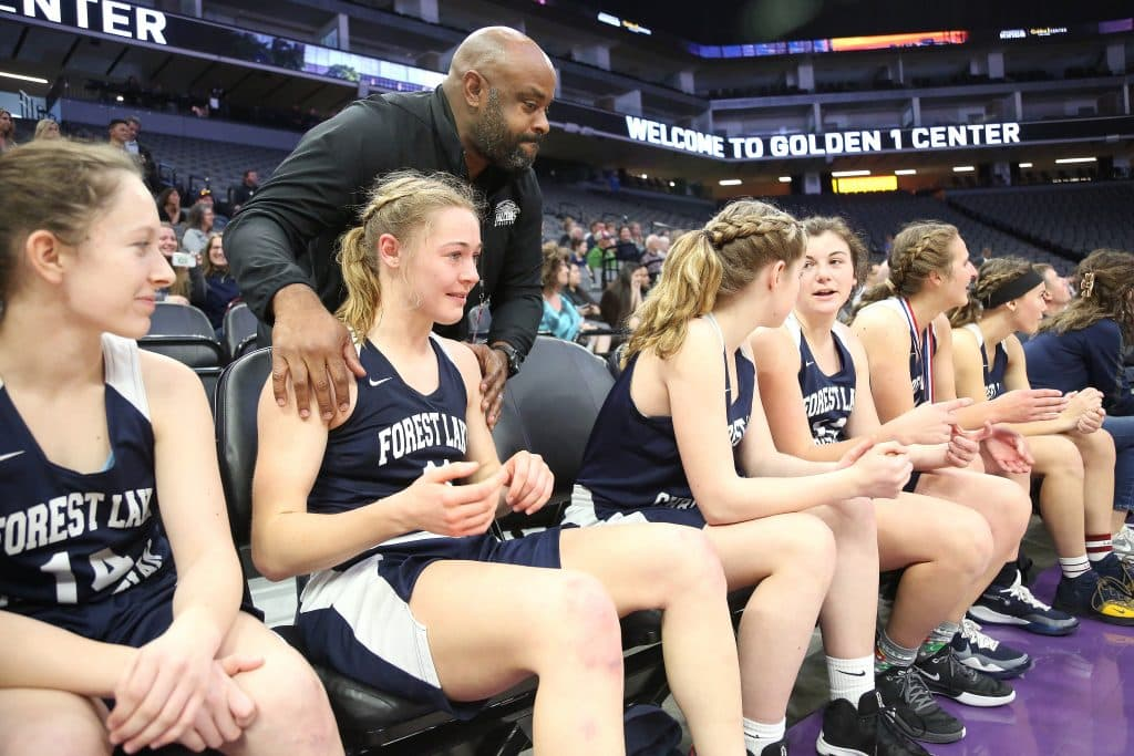 Forest Lake Christian Athletic Director LeRon Gordon congratulates members of the team following their D-6 championship win.