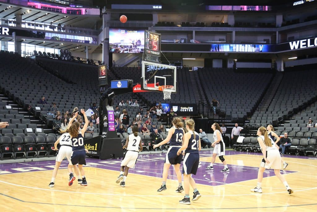 Forest Lake Christian freshman Sadie Whaley (20) takes a shot on basket during ThursdayÕs championship game at the Golden 1 Center.
