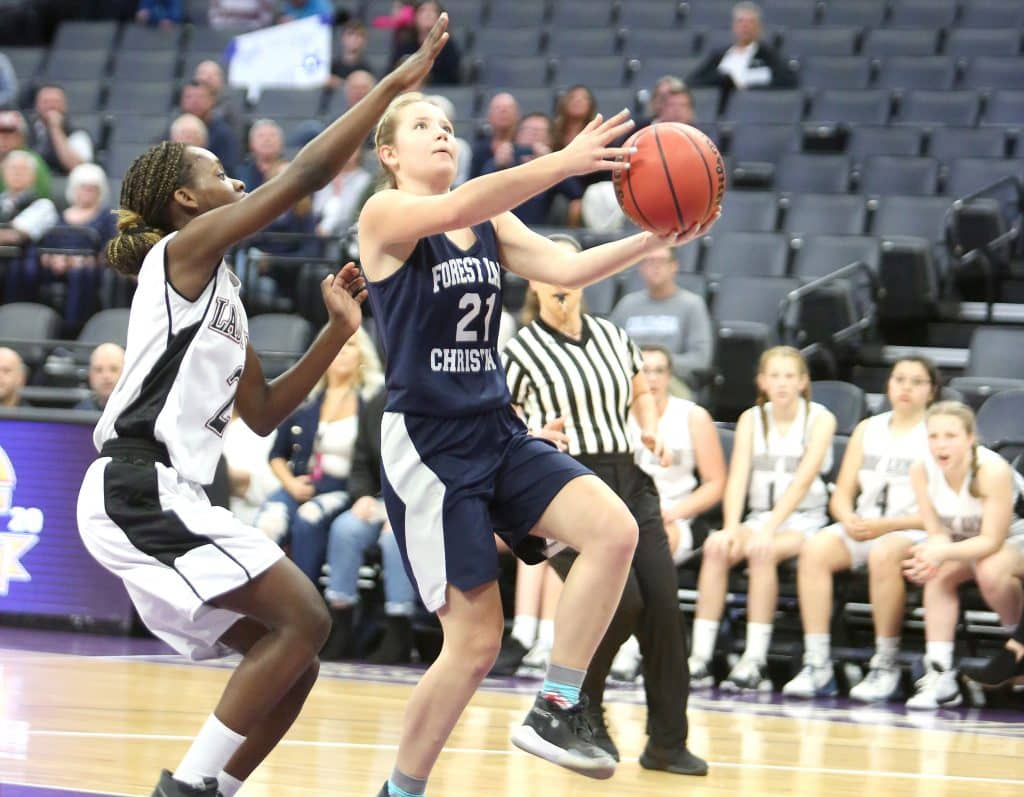 Forest Lake Christian junior Ellie Wood elevates to the basket during a fast break against the Valley Christian Lions.