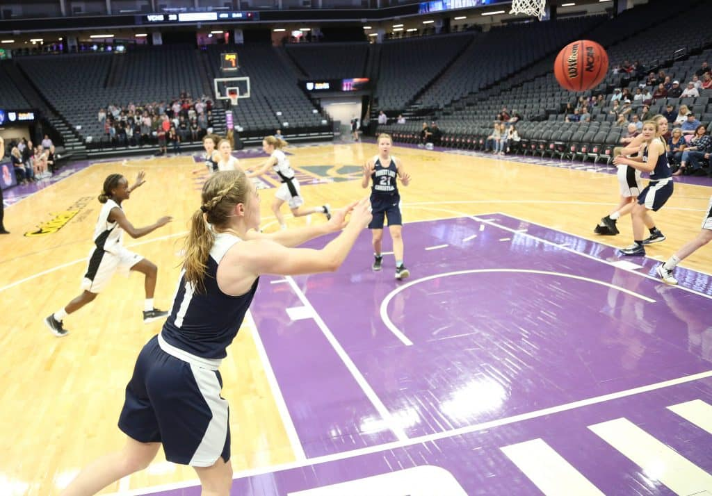 Forest Lake Christians Amber Jackson (11) makes an inbound pass to a teammate from the sidelines of ThursdayÕs championship game at the Golden 1 Center.