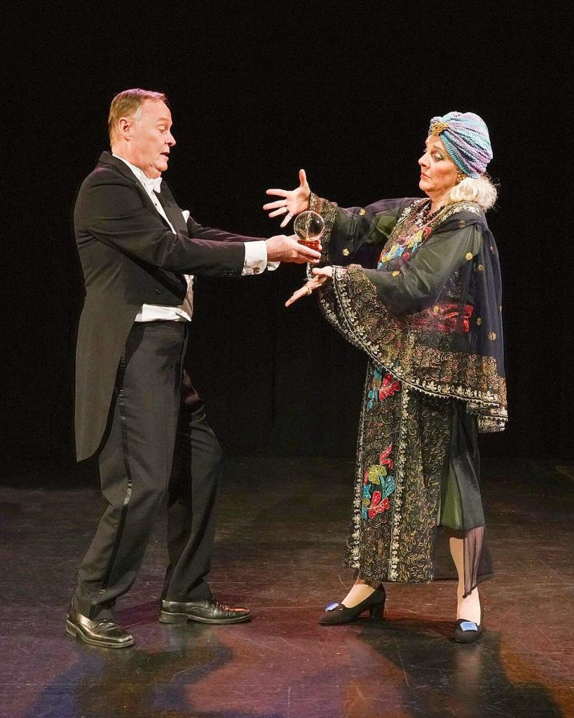 "Steve Lambert (as Charles) and Sara Noah (as Madame Arcati) in the Sierra Stages production of the classic Noël Coward comedy ""Blithe Sprit."