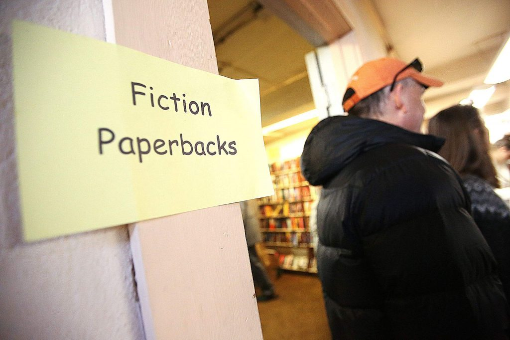 It's a cramped space in the basement of the Doris Foley Library where the first Saturday book sale is held, but folks are polite as they make their way past one another looking for that special book.