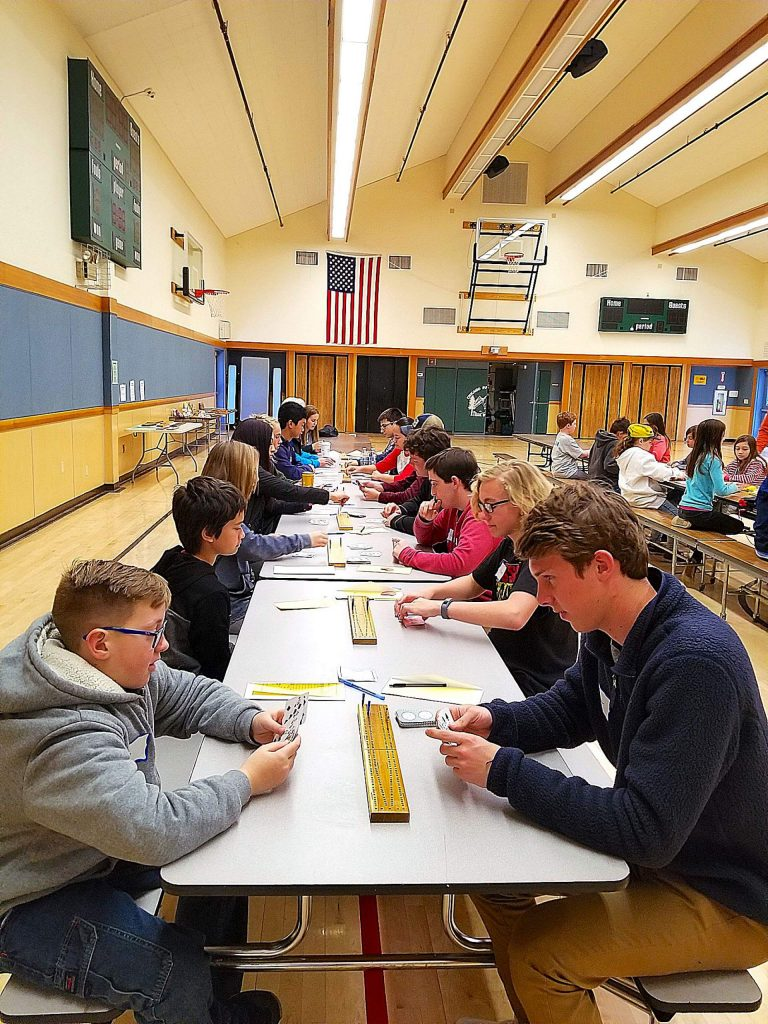 Students play cribbage last year at a tournament in Chicago Park School. This year was the 27th annual cribbage tournament hosted in the school's gymnasium.
