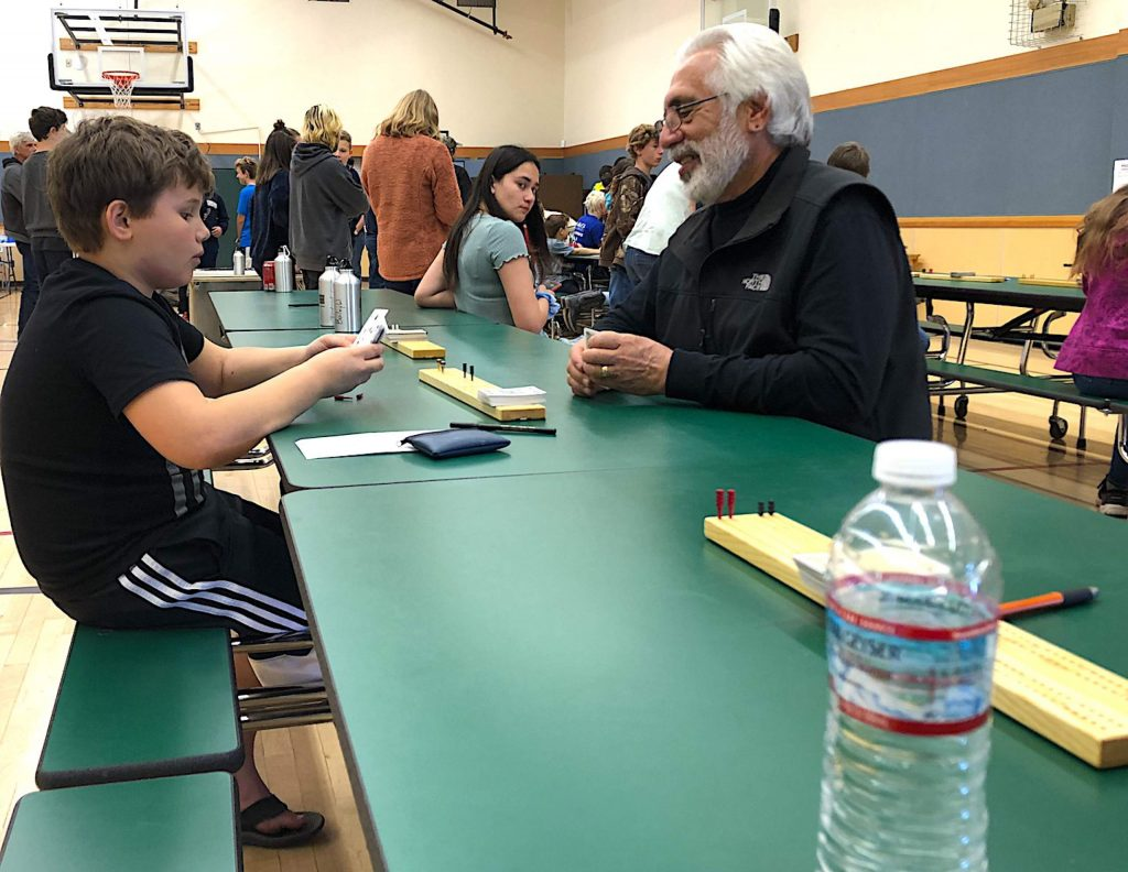 Judah Wilson, a fourth grader from Auburn, plays a game of cribbage with tournament proctor Joe Cilenti. Nathan Wilson, a 16-year-old from Grass Valley and Angelina Villalobos, an 11-year-old from Chico, took first place in their respective divisions.