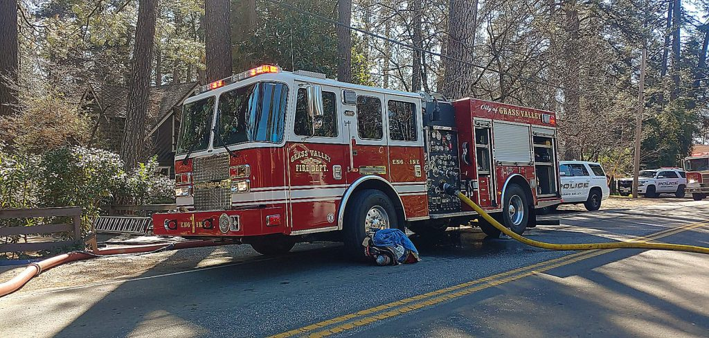 A fire truck sits outside the home where firefighters responded to calls of a structure fire Tuesday afternoon.