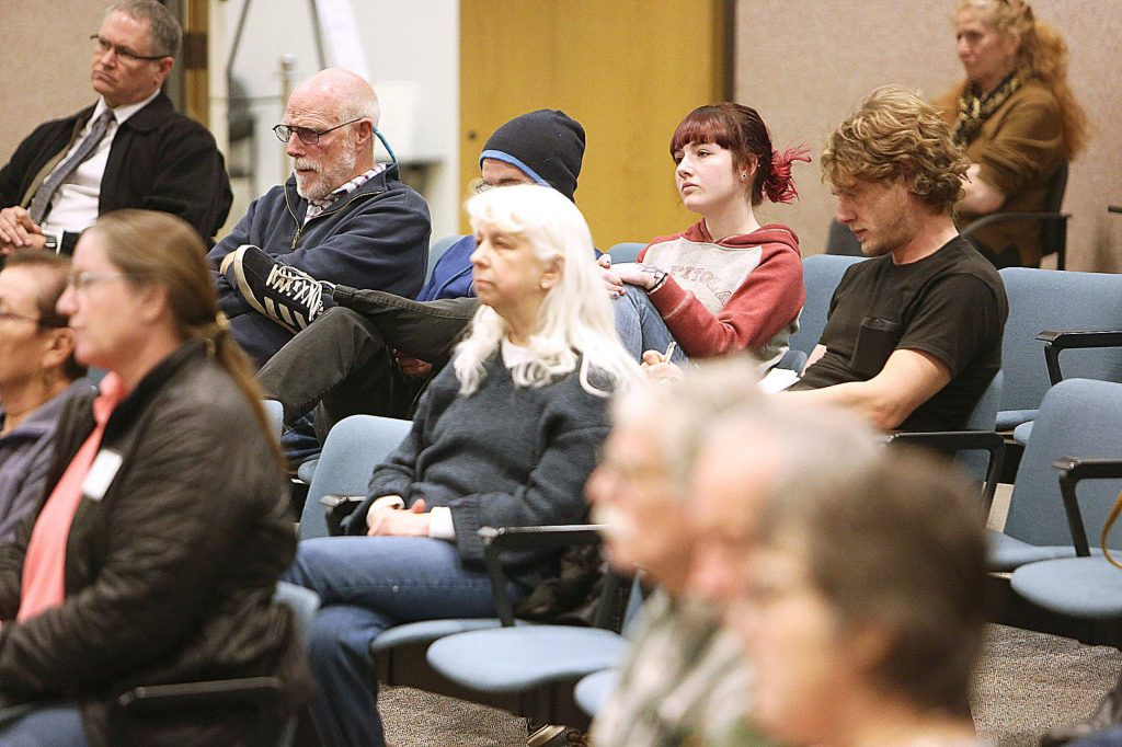 People in the audience listen to two candidates running for the District 1 seat on the state Senate.