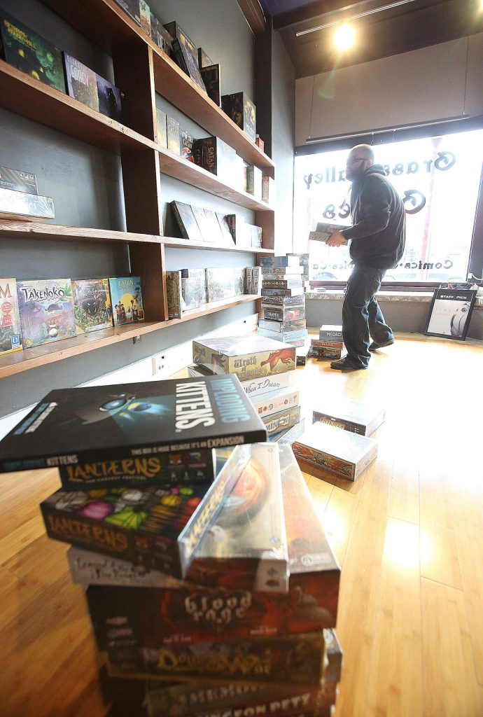 Zak Lewis, owner of Grass Valley Games, is excited to be moving into a much bigger space just a few doors down to where Three Lillies Photography once was. The store is open for business as Lewis continues to stock the shelves with inventory.