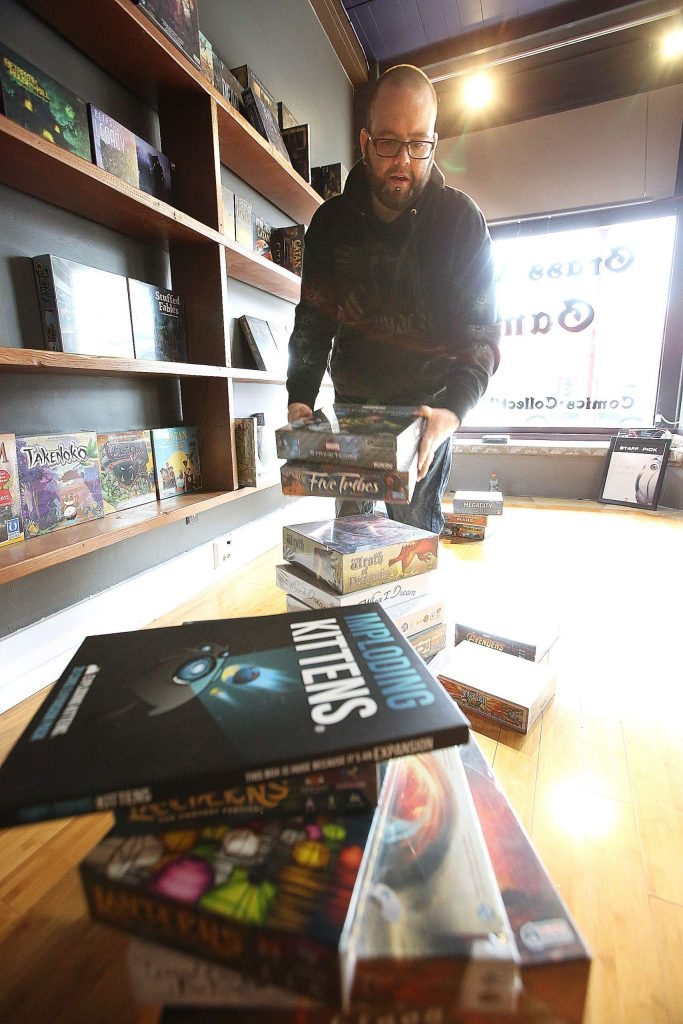 Zak Lewis, owner of Grass Valley Games, is excited to be moving into a much bigger space just a few doors down to where Three Lillies Photography once was. The store is open for business as Lewis continues to stock the shelves.