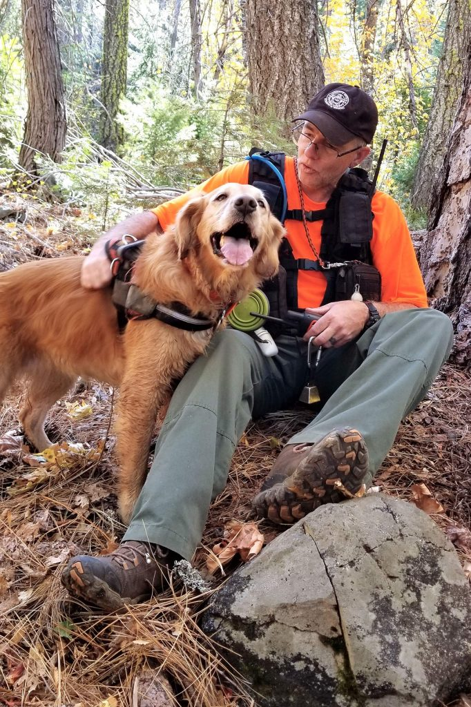 Groot and Rich Cassens take a break during a Search and Rescue training session.
