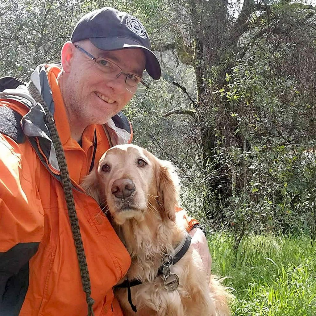 Rich Cassens with Sunny, his first Search and Rescue dog. Sunny now is 9 years old, but still works in the field occasionally.
