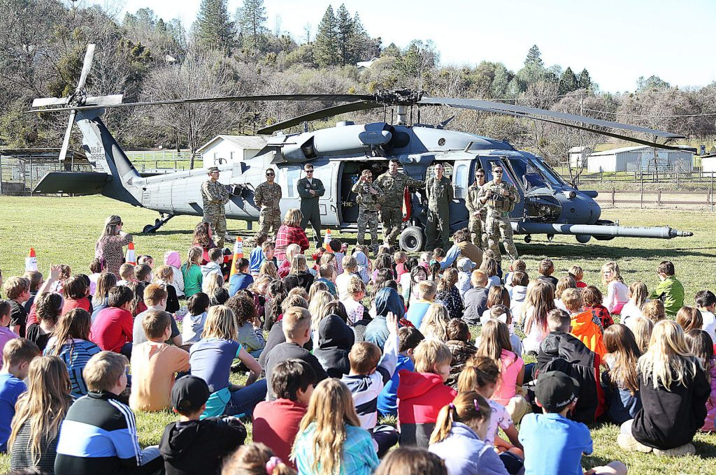 The crew of an Air National Guard Pave Hawk helicopter greets students and talks to them about the aircraft Thursday morning at Williams Ranch Elementary School in Penn Valley. The special event was arranged with the help of a student's parents based at Beale Air Force Base.