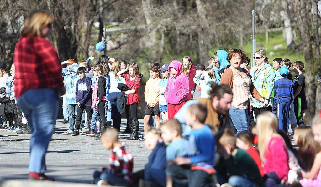 Williams Ranch Elementary School students watch from a distance as the Air Force helicopter lands at their school in Penn Valley.