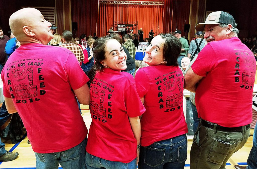 It was easy to identify members and supporters of the Grass Valley Sportsmen's Club Crab Feed by their matchy-matchy T-shirts, as proudly worn by, from left, event organizer Lee Matthews, Nora Matthews, Feliz Matthews, and Jeff Fierstein.