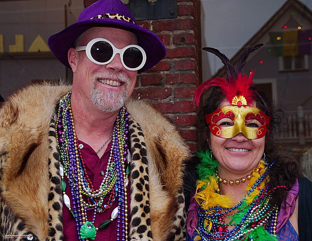 People are encouraged to attend the parade and street fair in festive Mardi Gras attire.