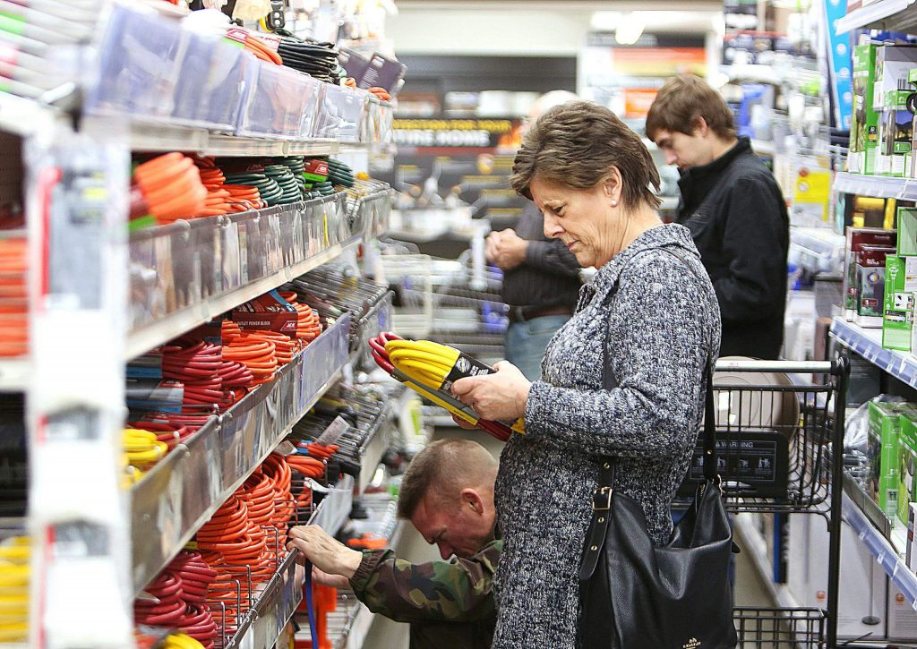 The aisles at B&C Ace hardware store in Grass Valley were full of shoppers buying extension cords, batteries, generators, kerosene, and other goods to help them through a planned PG&E power shutdown in this November file photo. Solar experts warn people against buying generators as they emit more carbon into the atmosphere and are an unsustainable source of power.