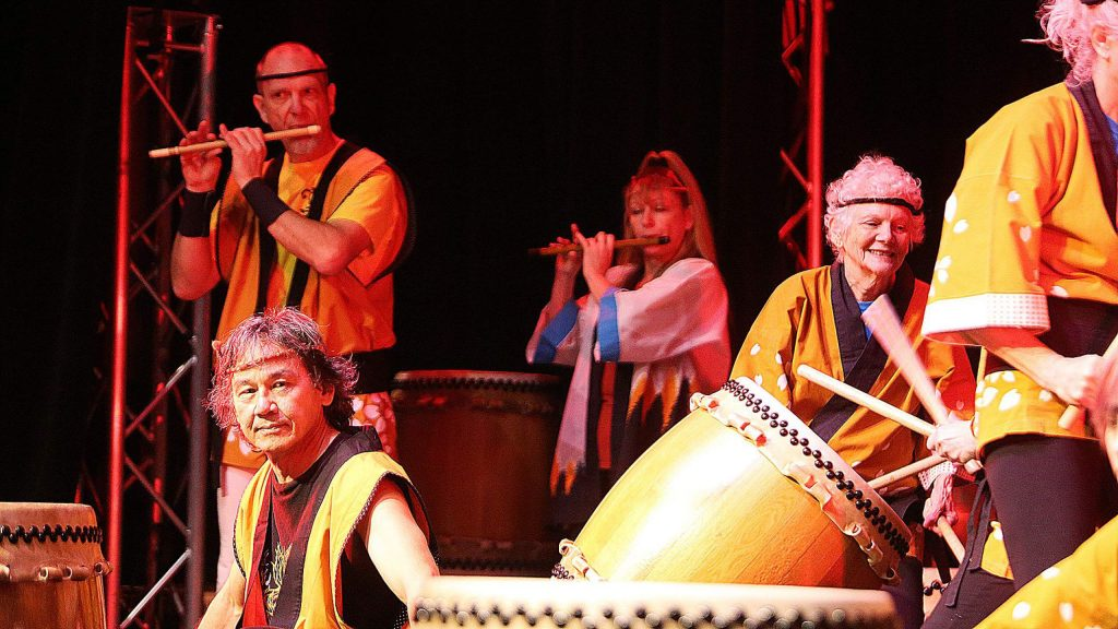 Grass Valley Taiko begins one a performance on stage at the Miners Foundry during Sunday's Festival.