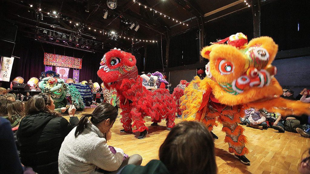 Eastern Ways Martial Arts performers present the lion dance to a packed house of folks Sunday at the Miners Foundry to celebrate the Year of the Rat and the Chinese Lunar New Year.
