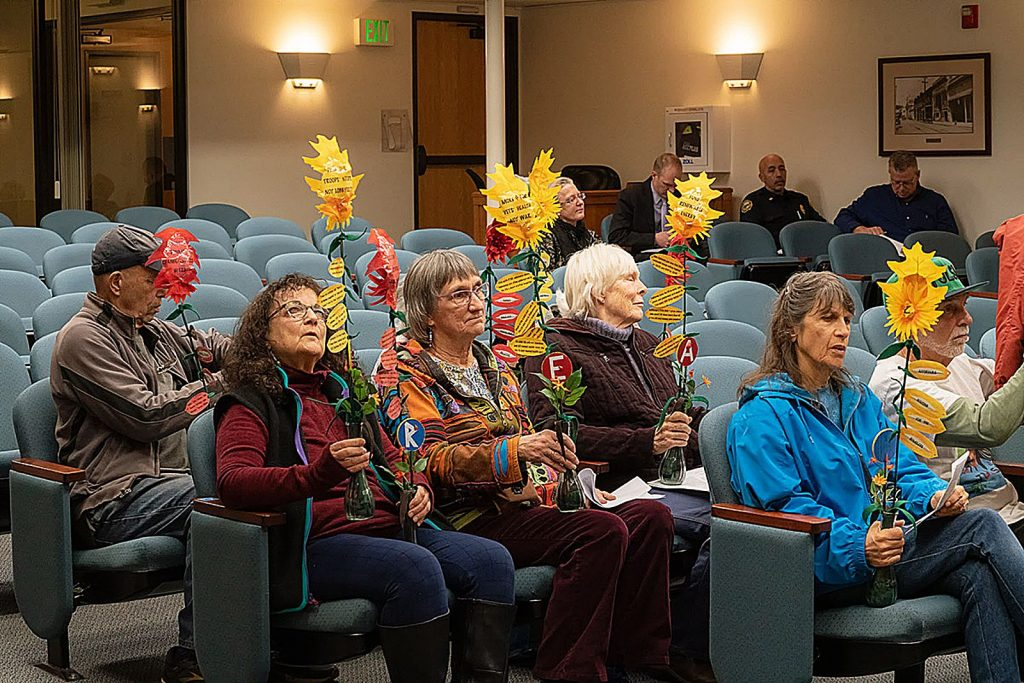 Proponents of the local peace budget resolution make their case during the public comment period of the Grass Valley City Council meeting on Feb. 11.
