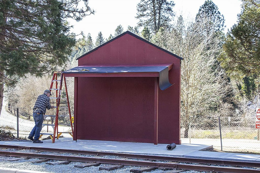 Work is progressing on the informational kiosk and historical monument to memorialize the county's railroad history on the grounds of the original train depot site, now Clamper's Square, between the northbound Highway 20 off-ramp and Railroad Avenue Nevada City.