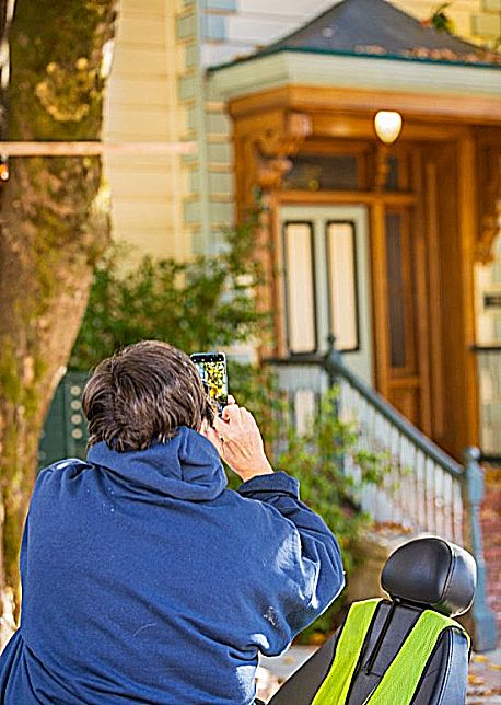 A woman on a PhotoWalk snaps a picture in downtown Nevada City.