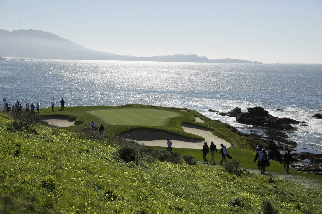 The playing group of James Hahn, Stephen Reyes, Scott Piercy and Jin Roy Ryu makes its way down to the seventh green of the Pebble Beach Golf Links during the second round of the AT&T Pebble Beach National Pro-Am golf tournament Friday in Pebble Beach, Calif.