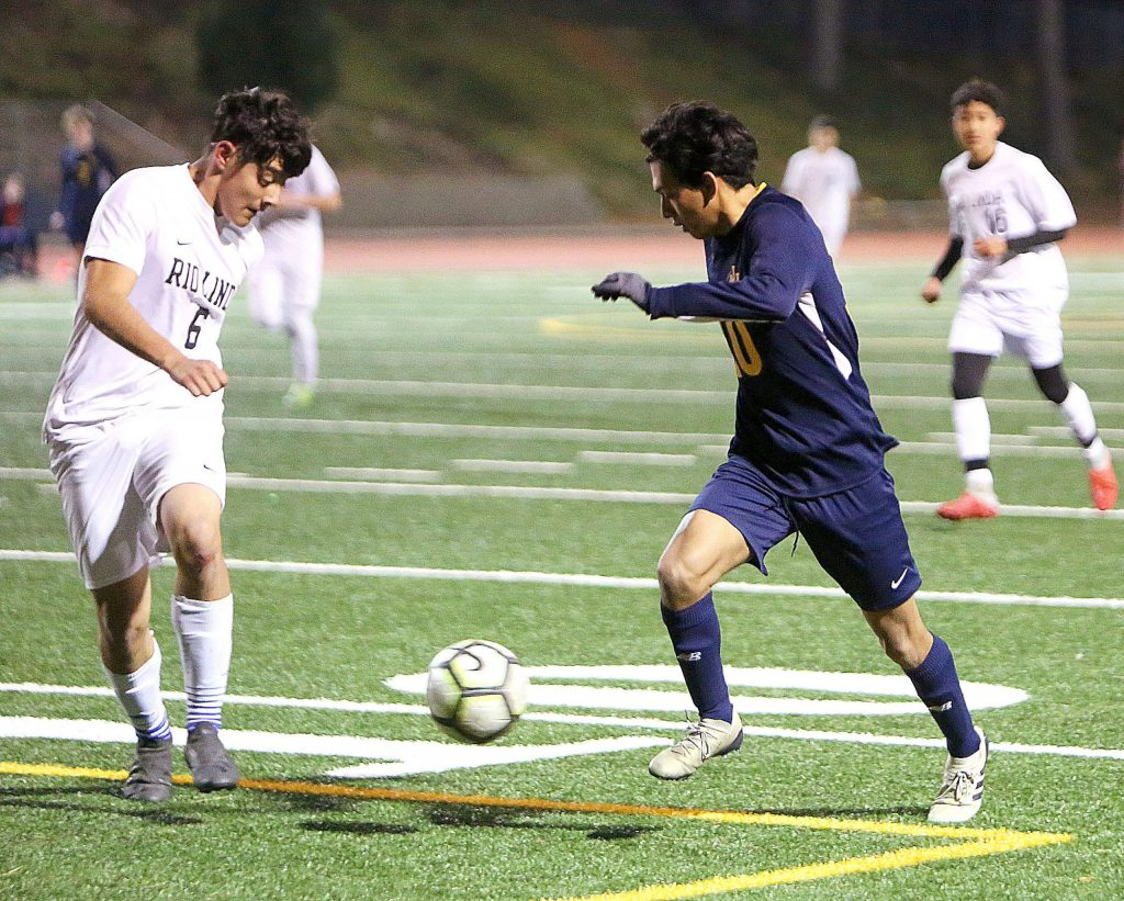 Nevada Union's Moises Tovar (10) goes toe to toe with a Rio Linda defender during Thursday's 3-2 hard fought win over the Knights.