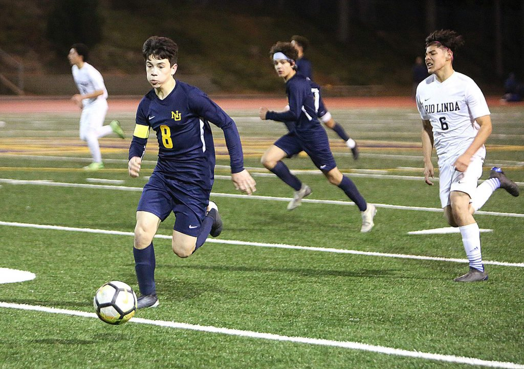 Nevada Union junior Bryce Nguyen (8) brings the ball up the field for the Miners during Thursday's home win against Rio Linda.