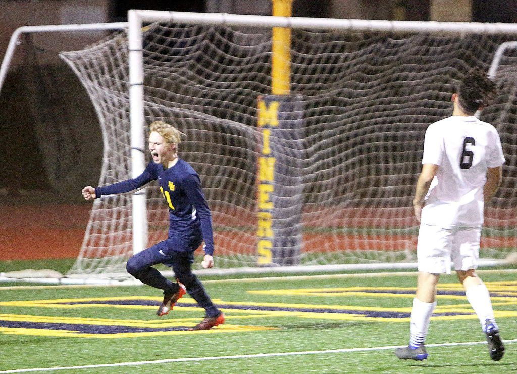 Nevada Union junior Jake Slade (11) celebrates after scoring the first goal of the game during the Miners' 3-2 win over visiting Rio Linda. The win was enough to secure the Miners a spot in the playoffs, something that hasn't happened for the soccer team since 2011.