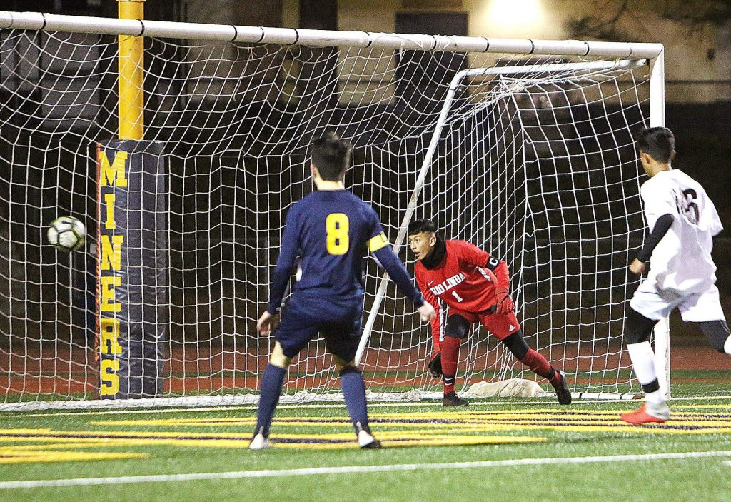 Rio Linda's goalkeeper looks on as a Nevada Union shot on goal nears the net during the Miners' hard fought win Thursday night at home.