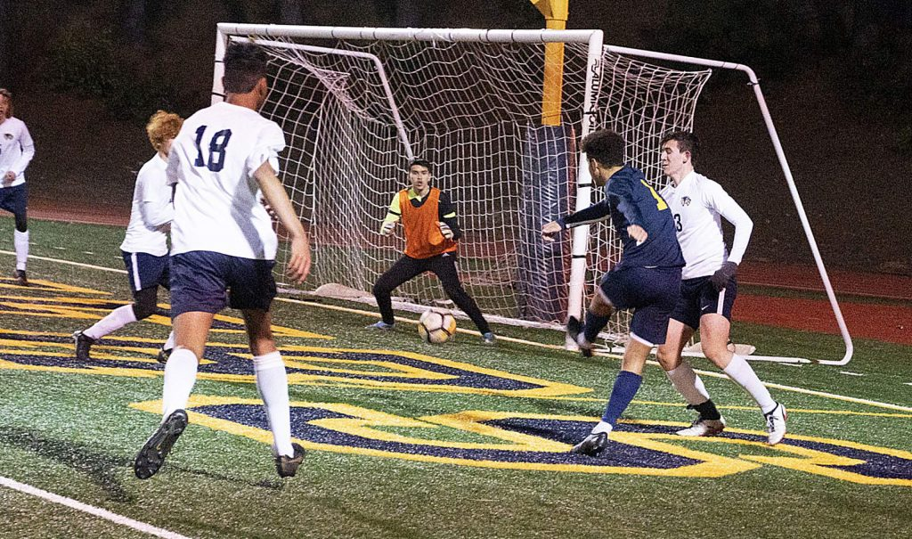 Nevada Union's Josh Smith scores one of his three goals against Rosemont Monday night at Hooper Stadium. The Miners beat Rosemont 3-1 in the first round of the Sac-Joaquin Section Division III playoffs.