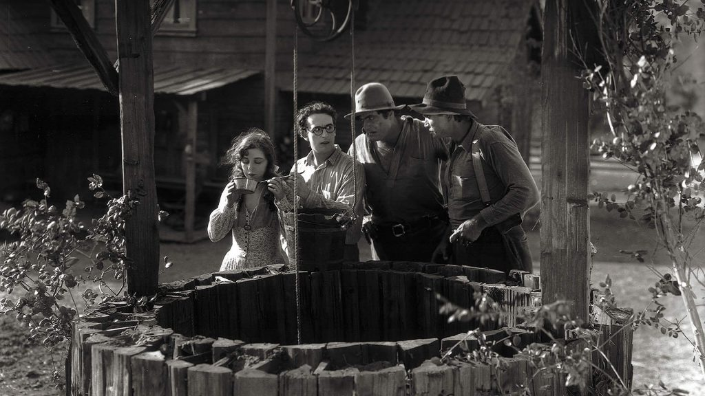 """The Kid Brother"" tells the story of a lawman's timid son, played by Harold Lloyd, second from left. Lloyd's character can't keep up with his two muscle-men brothers, right, but find inspiration when he meets a young woman who dances with a traveling medicine show, left."