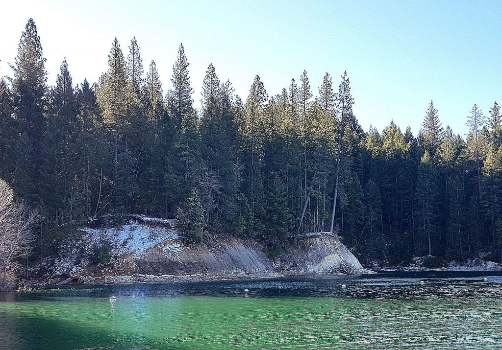 Some graupel remains on the hillsides in Cascade Shores above Scotts Flat Lake Monday morning.