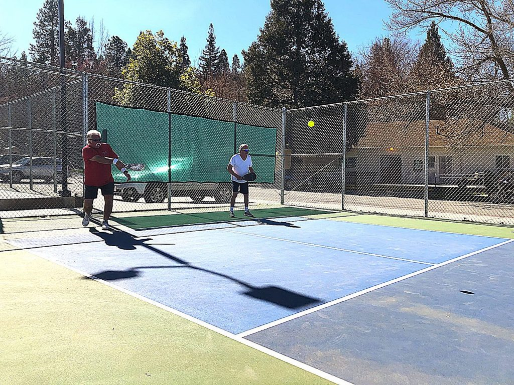 Bruce Mosley, left, and Tom Israelian play a doubles pickleball game.