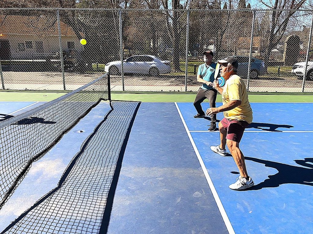 Art Deleon, foreground, and Norm Sash play pickleball on Tuesday at Memorial Park in Grass Valley during sunny weather that's forecast to extend through Friday.