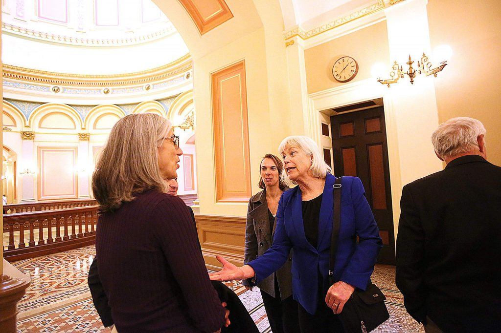 Amanda Wilcox talks with folks near the State Capital rotunda following Monday's resolution given in the Wilcox's honor.