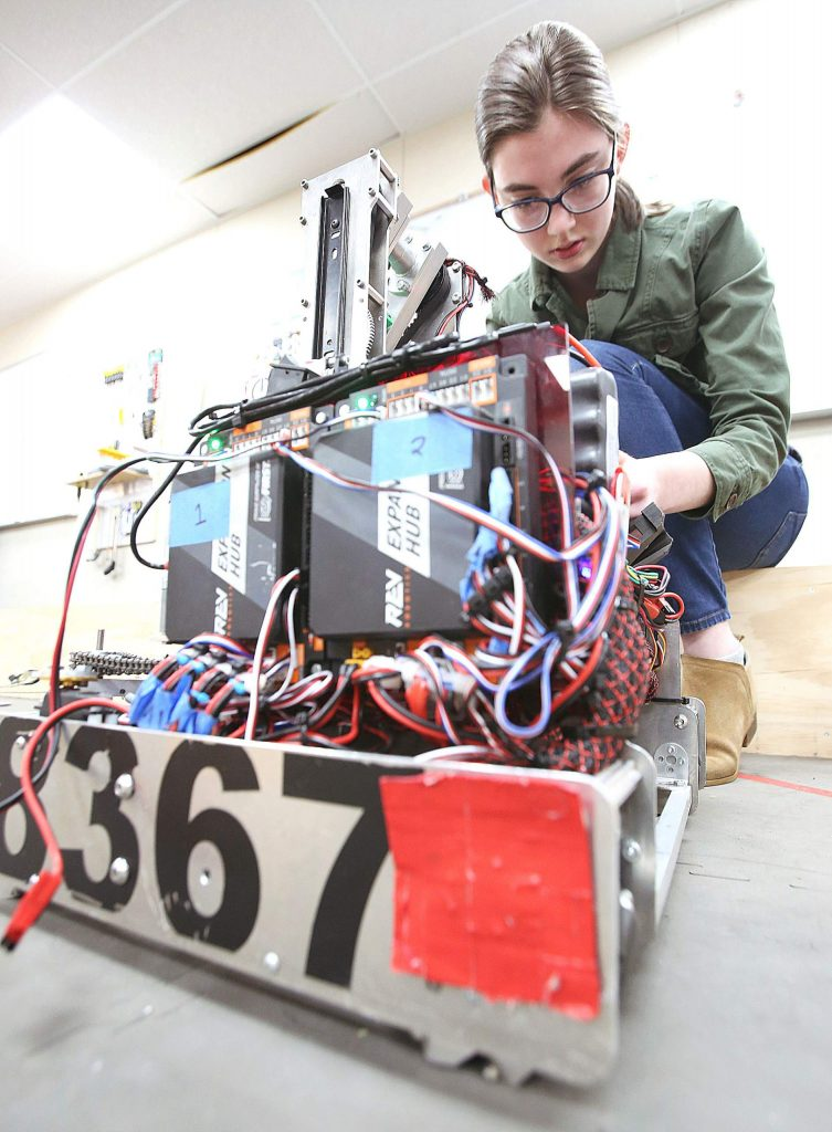Team ACME's Emma Sheffo works on programming her team's robot Tuesday afternoon.