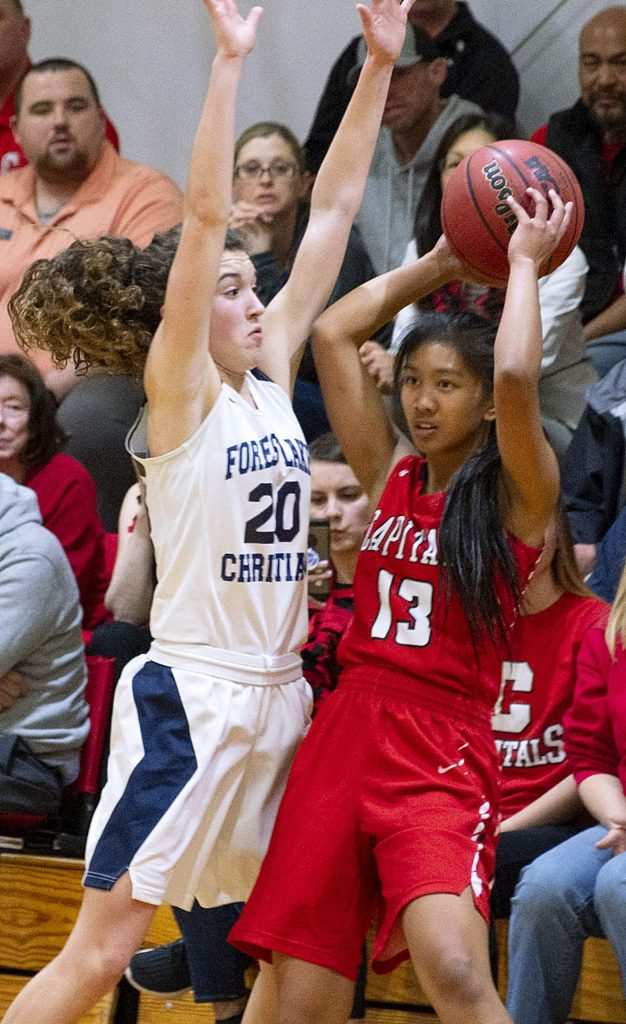 Forest Lake Christian's Sadie Whaley, left, played strong defense and scored 15 points in the Lady Falcons' semifinal win over Sacramento Adventist Monday night.