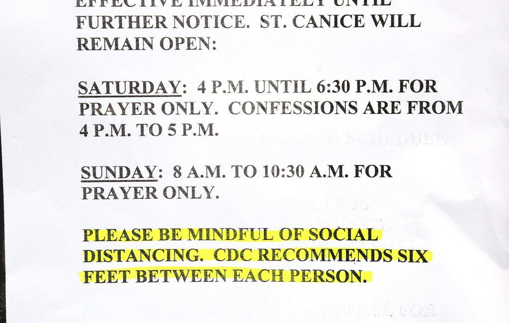 Signs such as these have been posted to the front doors of places of worship that have chosen to stay open in limited capacity.