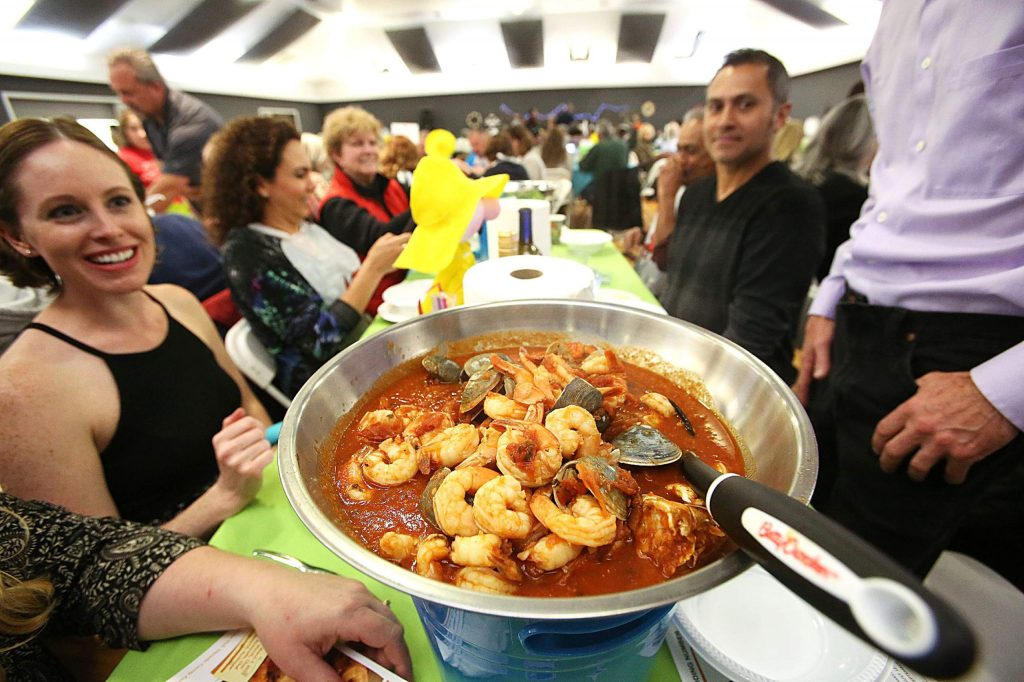 One of the most happening places in Nevada County Saturday night was undoubtedly the Foothill Lions Club's 10th annual all you can eat Cioppino and Pasta feed. Lions club members dished up the special recipe while Nevada County 4-H members helped serve the tables of the sold out event which is a fundraiser for the Nevada County Fairgrounds Foundation.