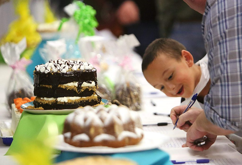 Six year old Cooper Tirado seemed to be more interested in the outcome of the silent dessert auction, which has become a popular part of the annual cioppino feed.