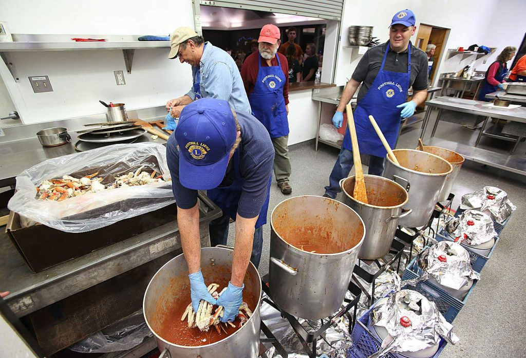 Foothill Lions Club works on adding the crab to the cioppino during Saturday's all you can eat feast held at the fairgrounds' Ponderosa Hall. This is the largest standalone fundraising event held by Foothill Lions for the Nevada County Fairgrounds Foundation.