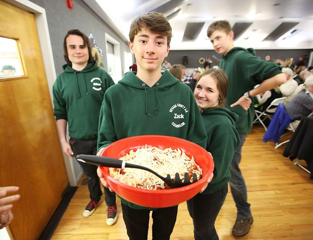 Kentucky Flat 4-H's Zack Schaffer and other Nevada County 4-H members were glad to volunteer to help serve the attendees of the annual cioppino and pasta feed and help benefit the fairgrounds foundation. The Nevada County Fairgrounds foundation works towards the betterment of the fairgrounds helping to pay for maintenance and emergency work, such as when a large pine tree fell into a building last winter at the fairgrounds.