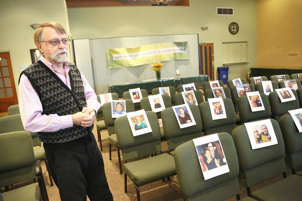 Unity in the Gold Country Spiritual Center's Rev. Jerry Farrell stands among pictures of his congregation, placed on the seats of the Cambridge Court center Thursday afternoon. Farrell is using Zoom and FaceTime to connect with people and will be using the sanctuary for a Wall of Remembrance to help those grieving their loved ones during this time.