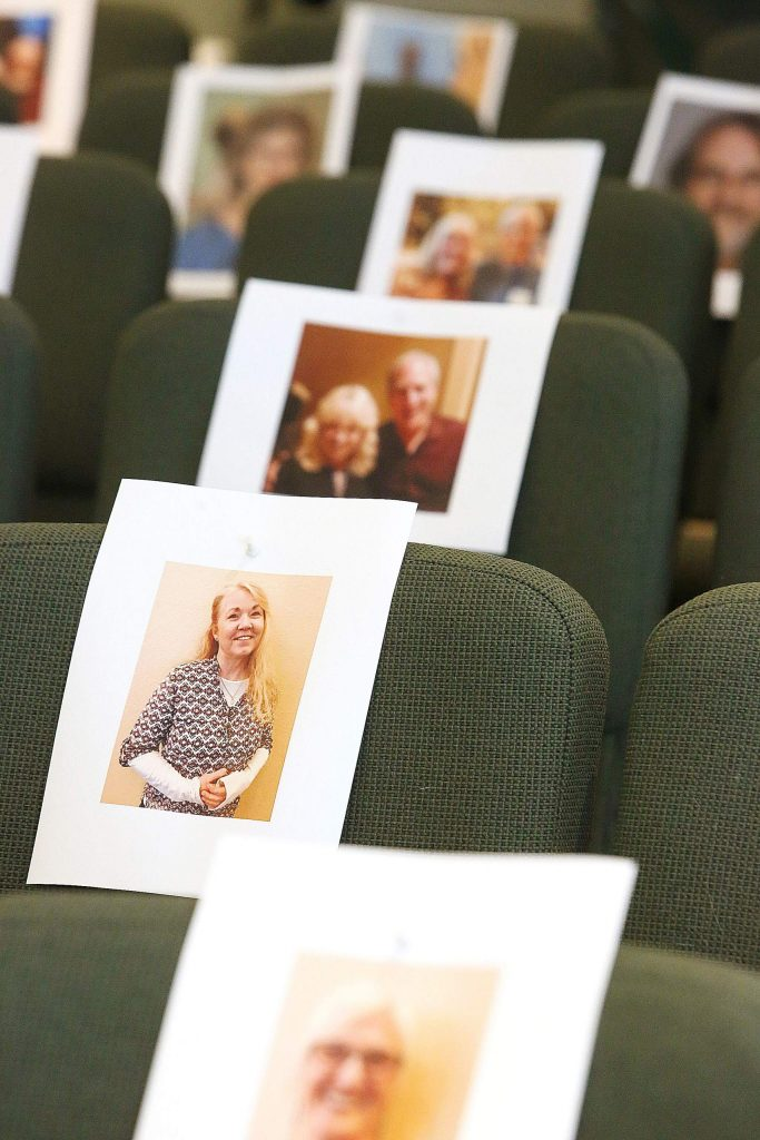 """""""It makes a huge difference,"""" Rev. Jerry Farrell said about the photos of his congregation in the seats. """"They're sending us their portraits. I love coming in here now."""""""